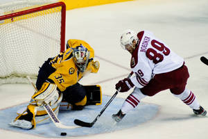Photo -   Nashville Predators goalie Pekka Rinne (35), of Finland, stops the shot of Phoenix Coyotes right wing Mikkel Boedker (89), of Denmark, in the first period of Game 4 in an NHL hockey Stanley Cup Western Conference semifinal playoff series, Friday, May 4, 2012, in Nashville, Tenn. (AP Photo/Mike Strasinger)