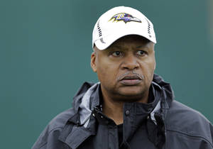 Photo - FILE - In this Jan. 30, 2013, file photo, Baltimore Ravens offensive coordinator Jim Caldwell walks onto the field as his team warms up during an NFL Super Bowl XLVII football practice in New Orleans. A person familiar with the situation says the Detroit Lions have hired coach Caldwell. (AP Photo/Patrick Semansky, File)