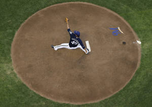 Photo - Milwaukee Brewers starting pitcher Yovani Gallardo throws during the first inning of a baseball game against the San Francisco Giants on Wednesday, Aug. 6, 2014, in Milwaukee. (AP Photo/Morry Gash)