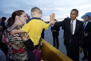 Photo -   President Barack Obama greets supporters on the tarmac upon his arrival at Denver International Airport in Denver, Thursday, Nov. 1, 2012. (AP Photo/Pablo Martinez Monsivais)