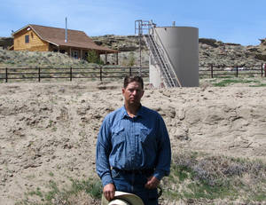"Photo -   ADVANCE FOR FRIDAY AMS MAY 4 - FILE - A May 22, 2009 picture shows John Fenton, a farmer who lives near Pavillion in central Wyoming, near a tank used in natural gas extraction, in background. Fenton and some of his neighbors blame hydraulic fracturing, or ""fracking,"" for fouling their well water. The U.S. Environmental Protection Agency drew skepticism and mistrust from Wyoming regulators after it privately briefed them more than a month in advance about its first-ever public announcement that hydraulic fracturing, a controversial but favored method for releasing difficult pockets of oil and gas, might have caused groundwater pollution. (AP Photo/Bob Moen, File)"