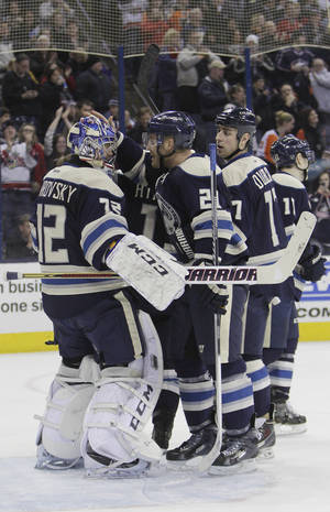Photo - Columbus Blue Jackets goalie Sergei Bobrovsky, left, of Russia, is congratulated after beating the Philadelphia Flyers in an NHL hockey game Thursday, Jan. 23, 2014, in Columbus, Ohio. The Blue Jackets extended their franchise record winning streak to eight games with a 5-2 win over the Flyers. (AP Photo/Jay LaPrete)
