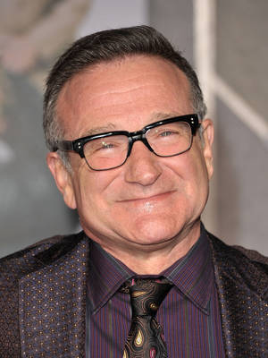 "Photo - <!-- Desert click tracking. Do not remove. --> <img class=""deseret-beacon"" src=""http://beacon.deseretconnect.com/beacon.gif?cid=195381&pid=109"" /><!-- End click tracking. -->  HOLLYWOOD: Robin Williams arrives at the ""Old Dogs"" Premiere at the El Capitan Theatre on November 9, 2009 in Hollywood, California."