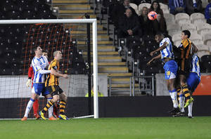 Photo - Hull City's Curtis Davies, third right, scores his side's first goal during the FA Cup Fifth Round replay soccer match against Brighton and Hove Ablion, at the KC Stadium, Hull, England, Monday Feb. 24, 2014. (AP Photo/PA, Anna Gowthorpe) UNITED KINGDOM OUT