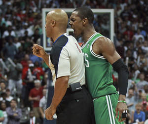 Photo -   Boston Celtics guard Rajon Rondo bumps referee Marc Davis late in the fourth quarter of Game 1 of a first-round NBA basketball playoff series between the Celtics and the Atlanta Hawks on Sunday, April 29, 2012, in Atlanta. Rondo was ejected. The Hawks won 83-74. (AP Photo/Boston Herald, Matthew West) BOSTON GLOBE OUT, METRO BOSTON OUT, MAGS OUT, ONLINE OUT