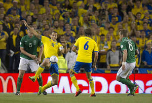 Photo - Sweden's Zlatan Ibrahimovic, second left, stretches for the ball during the World Cup qualifying Group C soccer match against Republic of Ireland at the Aviva Stadium, Dublin, Ireland, Friday Sept. 6, 2013. (AP Photo/PA, Liam McBurney) UNITED KINGDOM OUT  NO SALES  NO ARCHIVE