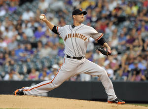 Photo -   San Francisco Giants starting pitcher Ryan Vogelsong throws during the first inning of a baseball game against the Colorado Rockies in Denver on Monday, Sept. 10, 2012. (AP Photo/Chris Schneider)
