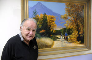 Photo - This June 2012 photo shows former 'Mad' magazine editor Al Feldstein standing near one of his paintings at Livingston HealthCare. Feldstein, whose 28 years at the helm of Mad magazine transformed the satirical publication into a pop culture institution, has died, Tuesday, April 29, 2014. He was 88. (AP Photo/Livingston Enterprise, Aaric Bryan)