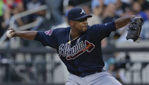 Photo - Atlanta Braves pitcher Julio Teheran (49) delivers against the New York Mets during the first inning of a baseball game, Tuesday, July 8, 2014, in New York. (AP Photo/Julie Jacobson)