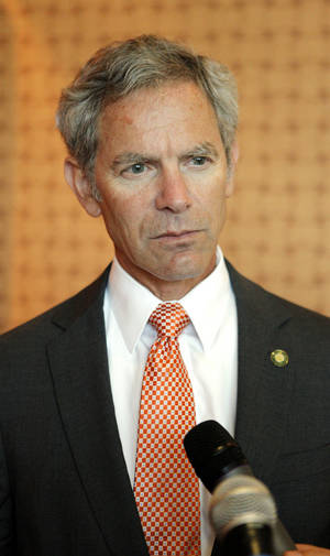 photo - Salt Lake City Mayor Ralph Becker speaks with reporters Wednesday during Oklahoma City Mayor Mick Cornett's development roundtable. The roundtable, an annual event, aims to gather local business and civic leaders to discuss the past and future development of the region. <strong>PAUL B. SOUTHERLAND - The Oklahoman</strong>