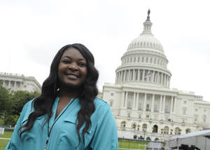 "Photo - FILE - This July 3, 2013 file photo shows American Idol 2013 winner Candice Glover on Capitol Hill in Washington. Glover from ""American Idol"" will help reopen the Washington Monument, which has been closed since a 2011 earthquake. Organizers say Glover will join with the Old Guard Fife and Drum Corps, the U.S. Navy Band and the boy and girl choristers of the Washington National Cathedral Choir for the May 12 re-opening ceremony. The ""Today"" show's Al Roker will host the event. (AP Photo/Susan Walsh, File)"