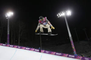 Photo - Shaun White of the United States gets air during a snowboard half pipe training session at the Rosa Khutor Extreme Park at the 2014 Winter Olympics, Monday, Feb. 10, 2014, in Krasnaya Polyana, Russia.  (AP Photo/Andy Wong)