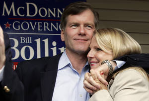 Photo - FILE- In this Oct. 31, 2009 file photo, Republican gubernatorial candidate Bob McDonnell, hugs his wife, Maureen, during a rally in Richmond, Va., McDonnell and his wife were indicted Tuesday, Jan. 21, 2014, on corruption charges after a monthslong federal investigation into gifts the Republican received from a political donor. (AP Photo/Steve Helber, File)