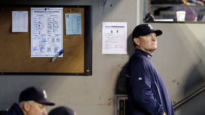 Photo - Seattle Mariners manager Eric Wedge looks out from the dugout during a baseball game against the Oakland Athletics Sunday, Sept. 29, 2013, in Seattle. Wedge announced days earlier that he would not be returning for the next season. (AP Photo/Elaine Thompson)