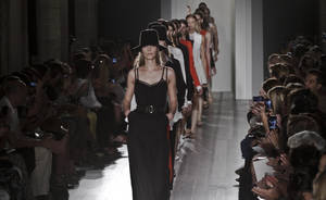 Photo -   Fashion from the Spring 2013 collection of Victoria Beckham is modeled on Sunday, Sept. 9, 2012 in New York. (AP Photo/Bebeto Matthews)