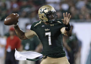 Photo -   South Florida quarterback B.J. Daniels prepares to throw a pass against Rutgers during the first quarter of an NCAA college football game Thursday, Sept. 13, 2012, in Tampa, Fla. (AP Photo/Chris O'Meara)