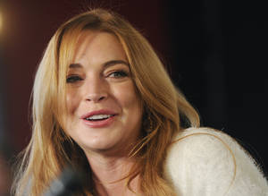 """Photo - FILE - In this Jan. 20, 2014 file photo, actress Lindsay Lohan addresses reporters during a news conference at the 2014 Sundance Film Festival in Park City, Utah. Lohan says she suffered a miscarriage during the taping of Sunday's final episode of her OWN cable channel reality TV series, """"Lindsay."""" (Photo by Chris Pizzello/Invision/AP, File)"""