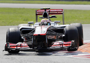 photo -   McLaren Mercedes driver Lewis Hamilton, of Britain, steers his car during the second free practice of the Italian Formula One Grand Prix, at the Monza racetrack, Italy, Friday, Sept.7, 2012 . The Formula one race will be held on Sunday. (AP Photo/Antonio Calanni)
