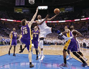 photo - Oklahoma City's Kevin Durant puts up a shot past Los Angeles' Pau Gasol during Game 2 in the second round of the NBA playoffs between the Oklahoma City Thunder and the L.A. Lakers at Chesapeake Energy Arena on Wednesday,  May 16, 2012, in Oklahoma City, Oklahoma. Photo by Chris Landsberger, The Oklahoman