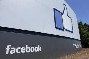 Photo - FILE - This Tuesday, July 16, 2013 file photo shows a sign at Facebook headquarters in Menlo Park, Calif. Facebook reports quarterly earnings on Wednesday, April 23, 2014. (AP Photo/Ben Margot, File)
