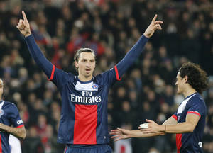 Photo - Paris Saint Germain's Zlatan Ibrahimovic of Sweden, and Edinson Cavani, right, celebrate after a goal against Lyon during their  French Premier League soccer match Sunday Dec. 1, 2013, in Parc des Princes stadium, in Paris, France. (AP Photo/Jacques Brinon)