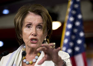 Photo - House Minority Leader Nancy Pelosi of Calif. gestures as she speaks during a news conference on Capitol Hill in Washington, Thursday, July 10, 2014.  (AP Photo/Manuel Balce Ceneta)