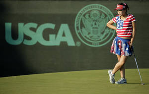 Photo - Lucy Li waits to putt on the 13th green during the first round of the U.S. Women's Open golf tournament in Pinehurst, N.C., Thursday, June 19, 2014. (AP Photo/Chuck Burton)