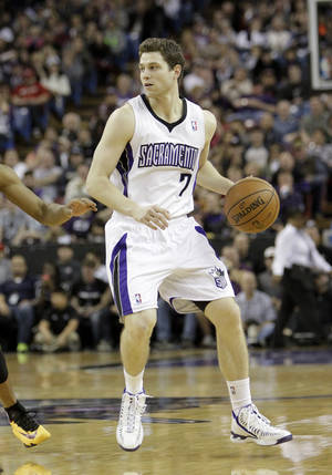 Photo - FILE -- In this Jan. 12, 2014, file photo, Sacramento Kings guard Jimmer Fredette looks to pass during an NBA basketball game against the Cleveland Cavaliers in Sacramento, Calif. The Kings announced they have completed a buyout of Fredette's contract, the team said Thursday, Feb. 27, 2014, clearing the way for the former BYU sensation to become a free agent. (AP Photo/Rich Pedroncelli, file)