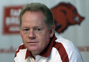 Photo -   FILE - This Aug. 6, 2011 file photo shows Arkansas college football coach Bobby Petrino speaking to reporters in Fayetteville, Ark. A State Police official says Petrino crashed his motorcycle Sunday night, April 1, 2012, on Arkansas Highway 16 in Madison County near the community of Crosses, and was taken to a hospital for treatment. (AP Photo/Danny Johnston, File)