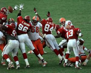 Photo - The Sooners' block of a Syracuse field-goal attempt preserved a 36-34 victory and inspired OU fans to storm the field in 1997. It was OU's third victory in 12 games under John Blake. <strong> - PHOTO BY STEVE SISNEY, THE OKLAH</strong>