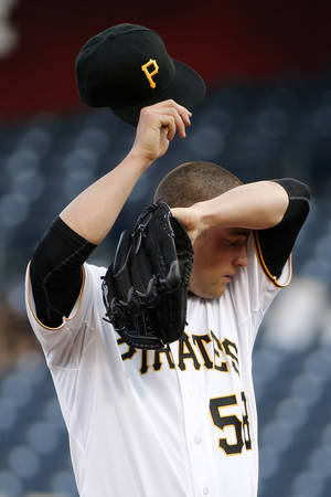 Photo - Pittsburgh Pirates starting pitcher Brandon Cumpton (58) wipes his head during the first inning of a baseball game against the Cincinnati Reds in Pittsburgh Tuesday, June 17, 2014. (AP Photo/Gene J. Puskar)