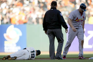photo -   San Francisco Giants second baseman Marco Scutaro (19) lies on the infield grass after being knocked down by St. Louis Cardinals&#039; Matt Holliday (7) during Game 2 of baseball&#039;s National League championship series, Monday, Oct. 15, 2012, in San Francisco. (AP Photo/The Sacramento Bee, Paul Kitagaki Jr.) MAGS OUT; LOCAL TV OUT (KCRA3, KXTV10, KOVR13, KUVS19, KMAZ31, KTXL40); MANDATORY CREDIT  