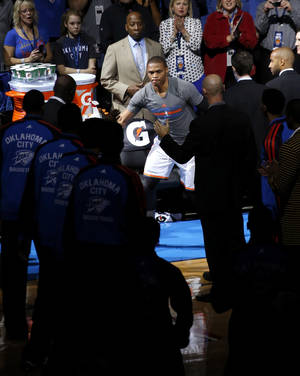 Photo - Oklahoma City's Russell Westbrook is introduced before an NBA basketball game between the Oklahoma City Thunder and the Phoenix Suns at Chesapeake Energy Arena in Oklahoma City, Sunday, Nov. 3, 2013. Photo by Bryan Terry, The Oklahoman