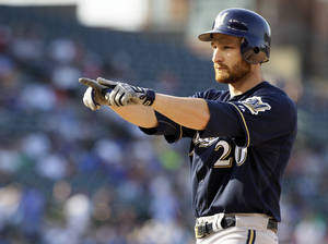Photo -   Milwaukee Brewers' Jonathan Lucroy points to the dugout after hitting an RBI single against the Chicago Cubs during the eighth inning of a baseball game in Chicago, Thursday, Aug. 30, 2012. (AP Photo/Nam Y. Huh)