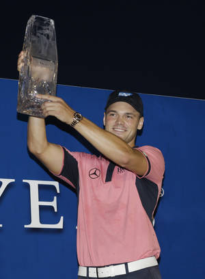 Photo - Martin Kaymer of Germany, lifts the The Players championship trophy TPC Sawgrass, Sunday, May 11, 2014 in Ponte Vedra Beach, Fla. (AP Photo/Lynne Sladky)