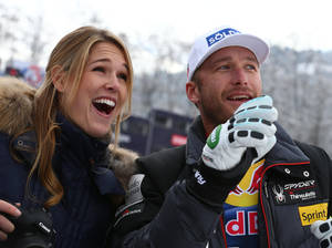 Photo - Bode Miller, of the United States, and his wife Morgan smile at the finish area at the end of an alpine ski, men's World Cup downhill, in Kitzbuehel, Austria, Saturday, Jan. 25, 2014. (AP Photo/Giovanni Auletta)
