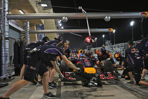 Photo - Mechanics prepares the racing car of German Formula One driver Sebastian Vettel of Red Bull during the second practice session of the Bahrain Formula One Grand Prix at the Formula One Bahrain International Circuit in Sakhir, Bahrain, Friday, April 4, 2014. The Bahrain Formula One Grand Prix will take place here on Sunday. (AP Photo/Kamran Jebreili)