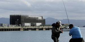 Photo - Two men fish near a Google barge Oct. 19 on Treasure Island in San Francisco.                    AP Archives Photo
