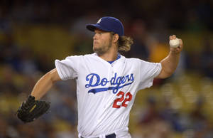 Photo - Los Angeles Dodgers starting pitcher Clayton Kershaw throws to a Colorado Rockies batter during the first inning of a baseball game, Friday, Sept. 27, 2013, in Los Angeles. (AP Photo/Mark J. Terrill)