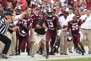 photo -   Mississippi State defensive back Johnthan Banks (13) runs after intercepting a pass in the first half of an NCAA college football game against Auburn Saturday, Sept. 8, 2012 in Starkville, Miss. (AP Photo/The Clarion-Ledger, Keith Warren) NO SALES