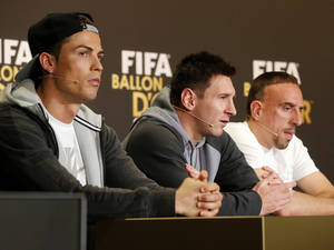 Photo - Real Madrid's Christiano Ronaldo of Portugal, FC Barcelona's Lionel Messi of Argentina, and Bayern Munich's Franck Ribery of France, from left, the three nominees for world soccer player of the year, take part in a press conference prior to the FIFA Ballon d'Or 2013 Gala in Zurich, Switzerland, Monday, Jan. 13, 2014. (AP Photo/Michael Probst)