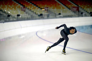 Photo - United States long track speed skater Shani Davis glides around a turn as he practices in Adler Arena for the 2014 Winter Olympics, Friday, Jan. 31, 2014, in Sochi, Russia. (AP Photo/David Goldman)