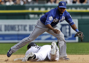 photo -   Detroit Tigers&#039; Prince Fielder slides safely into second base for a double as Kansas City Royals shortstop Tony Abreu cannot make the tag in the ninth inning of a baseball game in Detroit, Thursday, Sept. 27, 2012. Detroit won 5-4. (AP Photo/Paul Sancya)  