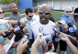 photo -   FILE - This July 31, 2012 file photo shows Detroit Lions general manager Martin Mayhew addressing the media before practice at their NFL football training camp in Allen Park, Mich. After being a league laughingstock for years, including being bad enough to become the NFL's first 0-16 team in 2008, the Lions are coming off a breakout season. (AP Photo/Carlos Osorio, File)