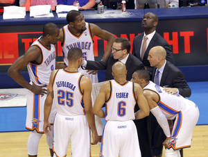 Photo - Head coach Scott Brooks huddles with the Thunder during Game 2 in the first round of the NBA playoffs between the Oklahoma City Thunder and the Memphis Grizzlies at Chesapeake Energy Arena in Oklahoma City, Monday, April 21, 2014. Photo by Sarah Phipps, The Oklahoman