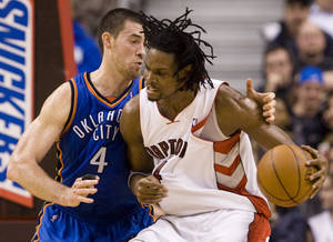 Photo - Toronto Raptors' Chris Bosh, right, goes up against Oklahoma City Thunder defender Nick Collison during first-half NBA basketball game action in Toronto, Friday, March 19, 2010. (AP Photo/The Canadian Press,Darren Calabrese) ORG XMIT: DBC107