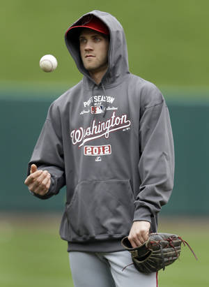 Photo -   Washington Nationals' Bryce Harper tosses a ball in the air during baseball practice, Saturday, Oct. 6, 2012, in St. Louis. The Nationals and the St. Louis Cardinals are scheduled to play Game 1 in the National League division series on Sunday. (AP Photo/Jeff Roberson)