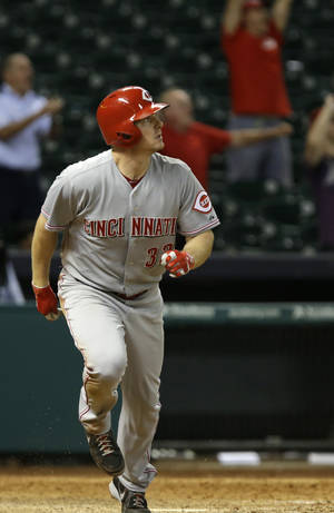 Photo - Cincinnati Reds' Jay Bruce watches the ball go out to center field for a two-run double against the Houston Astros in the 13th inning of a baseball game Wednesday, Sept. 18, 2013, in Houston. (AP Photo/Pat Sullivan)