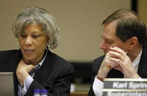 photo - File photo - School board chairperson Angela Monson, left, speaks with superintendent Karl Springer during an Oklahoma City Public Schools Board of Education meeting at 900 N Klein Avenue in Oklahoma City, Monday, March 7, 2011. Photo by Nate Billings