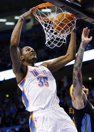 Photo -   Oklahoma City Thunder forward Kevin Durant (35) dunks in front of Denver Nuggets center Chris Anderson, right, in the fourth quarter of an NBA basketball game in Oklahoma City, Sunday, Feb. 19, 2012. Oklahoma City won 124-118 in overtime. (AP Photo/Sue Ogrocki)